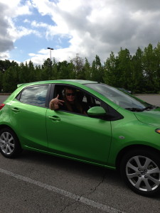 Can't believe he rented a bright green car. Have to admit, good gas mileage!